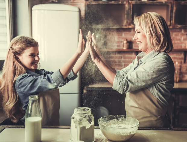 Grandma And Granddaughter In Kitchen